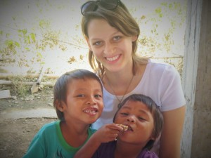 Elsa Thomasma, Director of GoAbroad Foundation, with a couple kids from Cangumbang